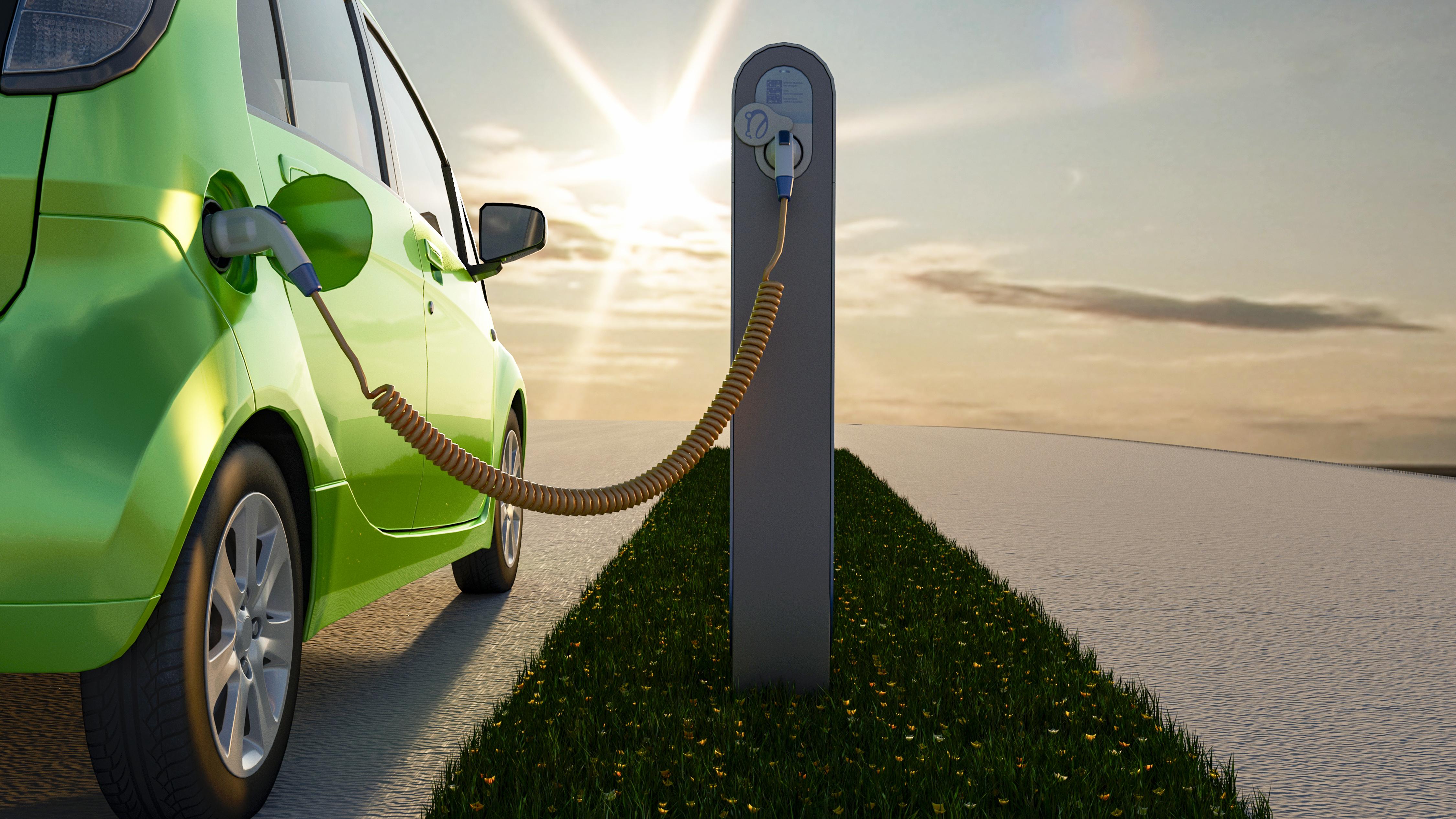 energia rinnovabile per il settore trasporti come i veicoli elettrici: auto e colonnina di ricarica